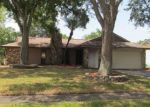 Foreclosed Home en FULMAR DR, Tampa, FL - 33625