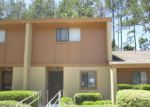 Foreclosed Home en DEBARRY AVE, Orange Park, FL - 32073