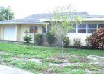 Foreclosed Home in SE 18TH CT, Cape Coral, FL - 33904