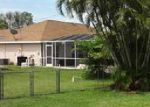 Foreclosed Home en SW 14TH TER, Cape Coral, FL - 33991