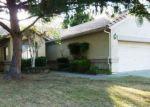 Foreclosed Home en PORTSMOUTH DR, Lodi, CA - 95242