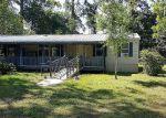 Foreclosed Home en DARDEN DR, Huffman, TX - 77336