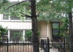 Foreclosed Home en N MULLIGAN AVE, Chicago, IL - 60639