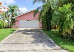 Foreclosed Home en SE 24TH ST, Cape Coral, FL - 33990
