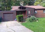 Foreclosed Home en TECUMSEH RIVER RD, Lansing, MI - 48906