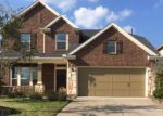 Foreclosed Home en EMBER VILLAGE LN, Tomball, TX - 77377