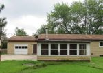 Foreclosed Home en WILCOX RD, Holt, MI - 48842