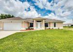 Foreclosed Home en NE 10TH LN, Cape Coral, FL - 33909