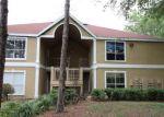 Foreclosed Home en HIGHLAND OAK DR, Tampa, FL - 33647