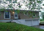 Foreclosed Home en WABASH AVE, Kansas City, MO - 64124