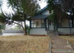 Foreclosed Home en SUMMIT ST, Evanston, WY - 82930
