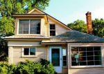 Foreclosed Home en W OAKLEY PARK RD, Walled Lake, MI - 48390