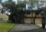 Foreclosed Home en ADRA AVE, Miami, FL - 33178