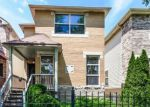 Foreclosed Home en S WOODLAWN AVE, Chicago, IL - 60619