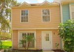 Foreclosed Home en RAMBLING VINE DR, Tampa, FL - 33624