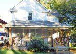 Foreclosed Home en MERSINGTON AVE, Kansas City, MO - 64124