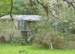 Foreclosed Home en TOWER GLEN LN, Conroe, TX - 77306
