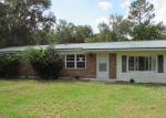 Foreclosed Home en SE COUNTRY CLUB RD, Lake City, FL - 32025