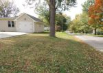 Foreclosed Home in N HARRISON ST, Kansas City, MO - 64118