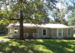 Foreclosed Home en N TWELVE OAKS DR, Splendora, TX - 77372