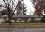 Foreclosed Home en E SANTA ANA AVE, Fresno, CA - 93726