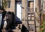 Foreclosed Home en BAKER ST, Baltimore, MD - 21216
