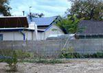 Foreclosed Home en BELLAMAH AVE NE, Albuquerque, NM - 87112