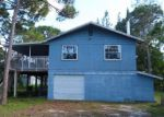 Foreclosed Home en WHISPERING PINES DR, Saint James City, FL - 33956