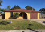 Foreclosed Home in W IDLEWILD AVE, Tampa, FL - 33614