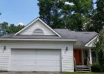 Foreclosed Home in OAKCREST RD, Howell, MI - 48843