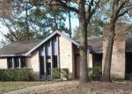 Foreclosed Home in RIVERWOOD PARK DR, Kingwood, TX - 77345
