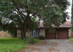 Foreclosed Home in WOODNETTLE LN, Houston, TX - 77086