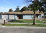 Foreclosed Home in E ROBINSON AVE, Fresno, CA - 93726