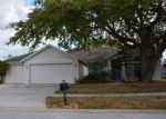 Foreclosed Home in BAYCOVE LN, Lutz, FL - 33549