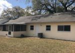 Foreclosed Home en OAK BLUFF DR, Orlando, FL - 32827