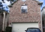 Foreclosed Home in W PALM LAKE DR, Houston, TX - 77034
