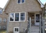 Foreclosed Home en N LEAMINGTON AVE, Chicago, IL - 60639