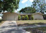 Foreclosed Home en NE SOLIDA CIR, Port Saint Lucie, FL - 34983