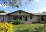 Foreclosed Home en SW ASTER RD, Port Saint Lucie, FL - 34953
