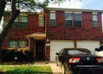 Foreclosed Home en TURQUOISE STREAM DR, Houston, TX - 77095