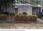 Foreclosed Home in NE 16TH CT, Fort Lauderdale, FL - 33305