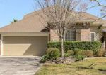 Foreclosed Home in TAMARIND TRL, Kingwood, TX - 77345