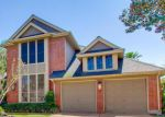 Foreclosed Home en S HEARTHSTONE GREEN DR, Houston, TX - 77095