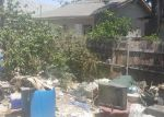 Foreclosed Home en E 42ND PL, Los Angeles, CA - 90011