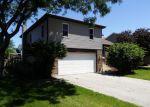 Foreclosed Home en RIDGE AVE, Aurora, IL - 60504