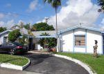 Foreclosed Home en NE 185TH TER, Miami, FL - 33179
