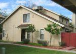 Foreclosed Home en E BROADWAY RD, Mesa, AZ - 85204