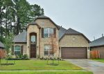 Foreclosed Home en CAMELOT LEGEND DR, Tomball, TX - 77375
