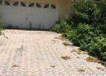 Foreclosed Home in SW 212TH TER, Miami, FL - 33189