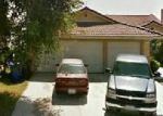 Foreclosed Home en GRANADA AVE, Fontana, CA - 92335